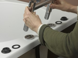 Lowering in new bath taps