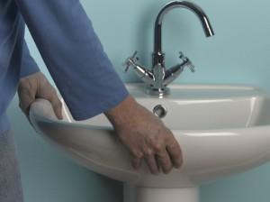 lifting new basin onto pedestal