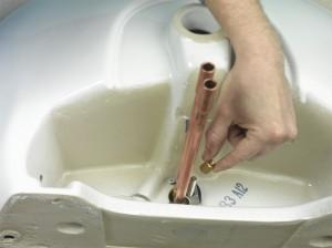 doing up retaining nut onto tap