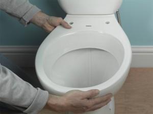 pushing toilet into pan connector