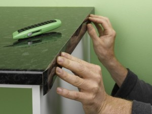 Fitting kitchen worktop edging strip