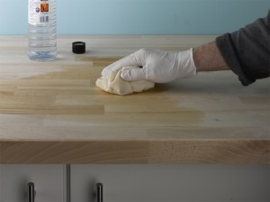 cleaning down wooden worktop