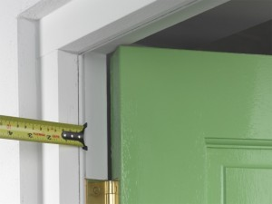 marking edge of door frame for draught excluder