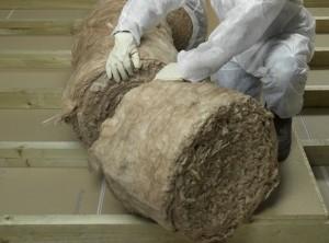 unwrapping loft insulation