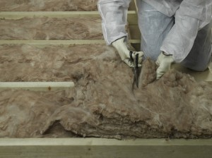 trimming lengths of loft insulation