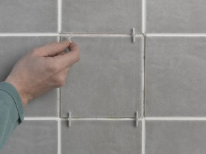 inserting tile spacers