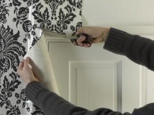 trimming wallpaper around door