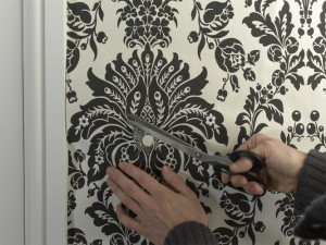 cutting wallpaper at fitting