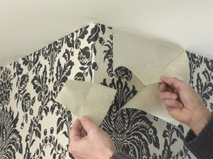 wallpapering around corners and removing excess