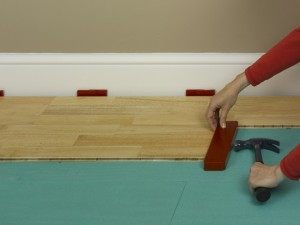 engineered floor knocking block