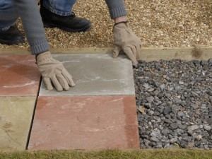 Dry laying paving slabs