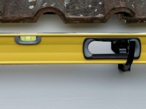 Using spirit level to maintain gutter gradient