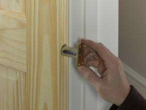 inserting door closer cylinder into edge of door