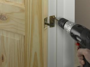 screwing door closer anchor plate in position