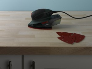 Sanding wooden kitchen worktop