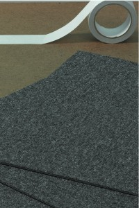 Laying vinyl tiles or carpet tiles
