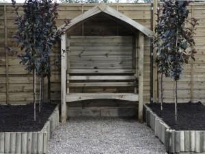 Arbour against fence