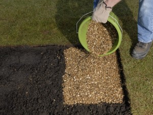 putting bed of gravel below slabs