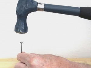 Setting a nail with a hammer