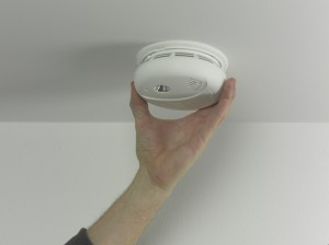 fitting smoke alarm in place