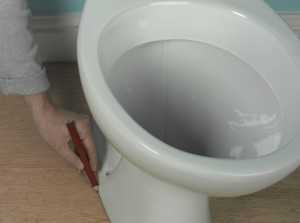 making pencil guideline around the edge of the toilet pan