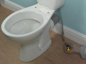 turning on isolation valve for toilet supply
