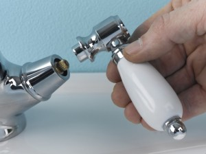 Removing tap handle to reveal tap valve