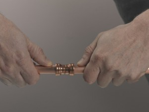 Pushing copper pipe into joint