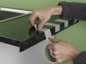 using masking tape to hold worktop edging strip in place