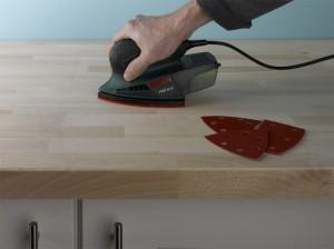 sanding wooden kitchen worktop