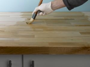 applying oil to wooden kitchen worktop