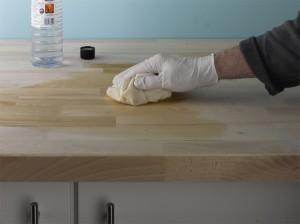 cleaning down wooden worktop