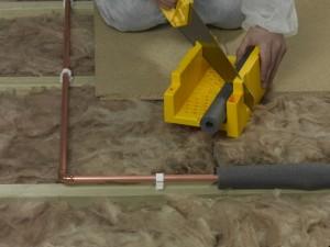 mitre corners of pipe insulation