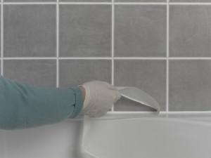 removing masking tape and smoothing sealant