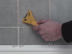 removing hardened tile adhesive