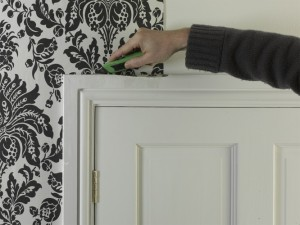 trimming wallpaper with craft knife or scissors