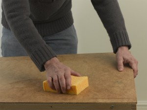 wiping pasting table to remove wallpaper paste