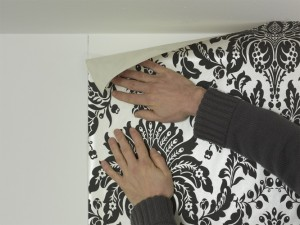 hanging first piece of wallpaper