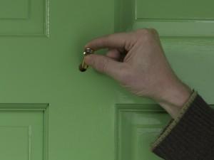screwing in lens piece of door viewer