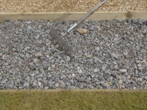 raking and compacting hardcore