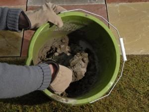 mixing mortar in a bucket