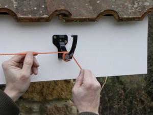 Tie string line to gutter clip