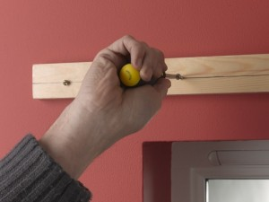 Fixing screws into batten