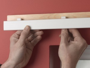 Clipping curtain track onto brackets