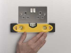 Fixing socket in place with retaining screws