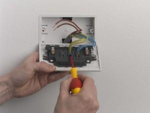 Unscrewing terminal screws at socket