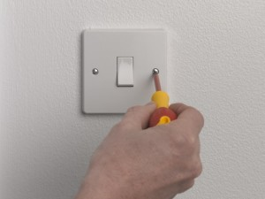 Unscrewing light switch plate